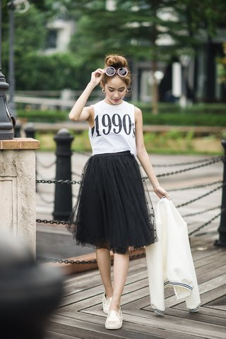 Popo Tulle midi skirt in black dot